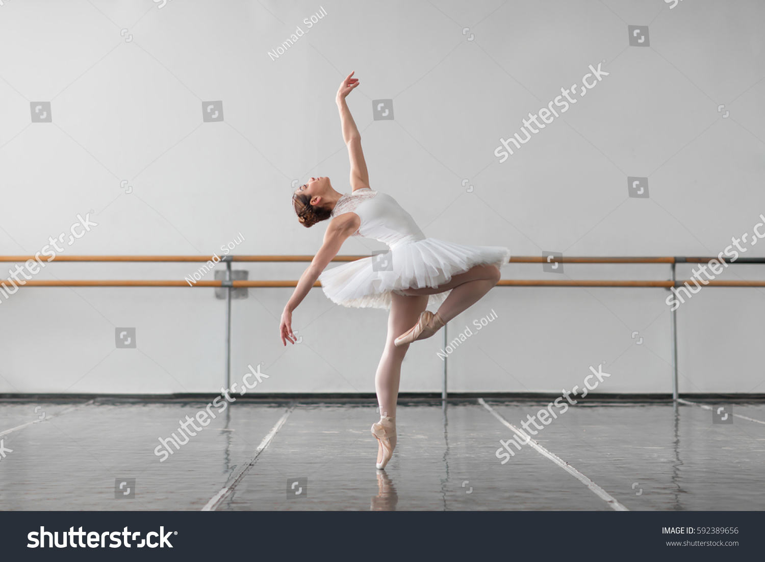 stock-photo-female-ballet-dancer-keep-the-rack-in-class-592389656